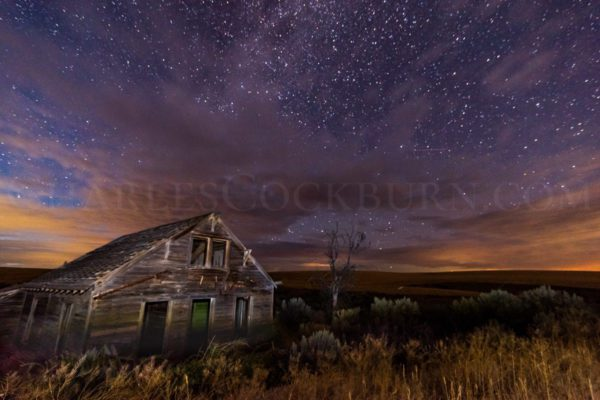 The skies sparkle and shine above an old abandoned home just east of Waterville in Central Washington State.