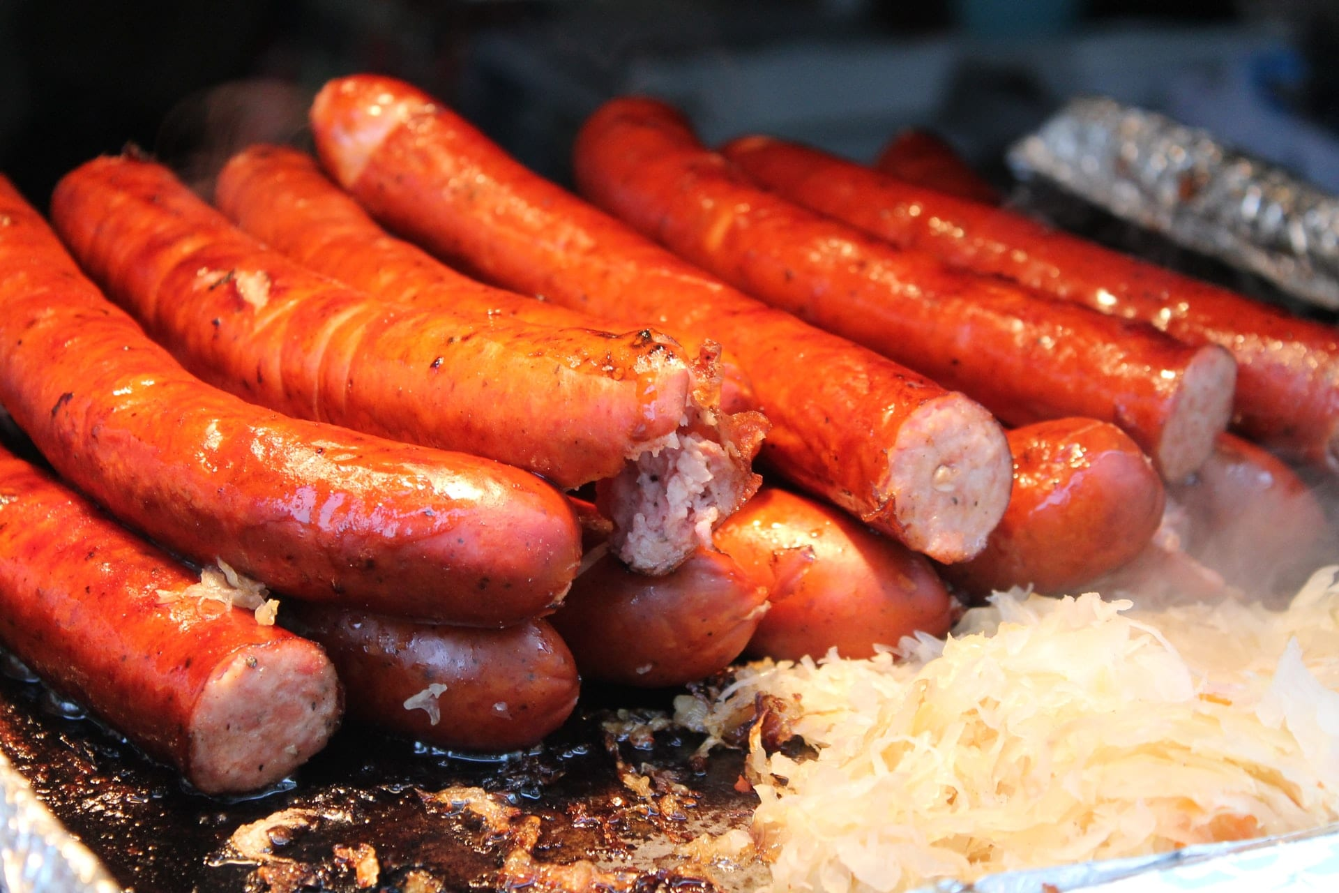 Sausages and sauerkraut on a flattop grill